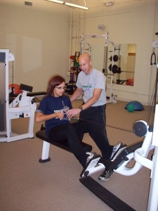 CoachMeFit Birmingham Owner, Derek DiGiovanni, guides Amy through one of her workouts